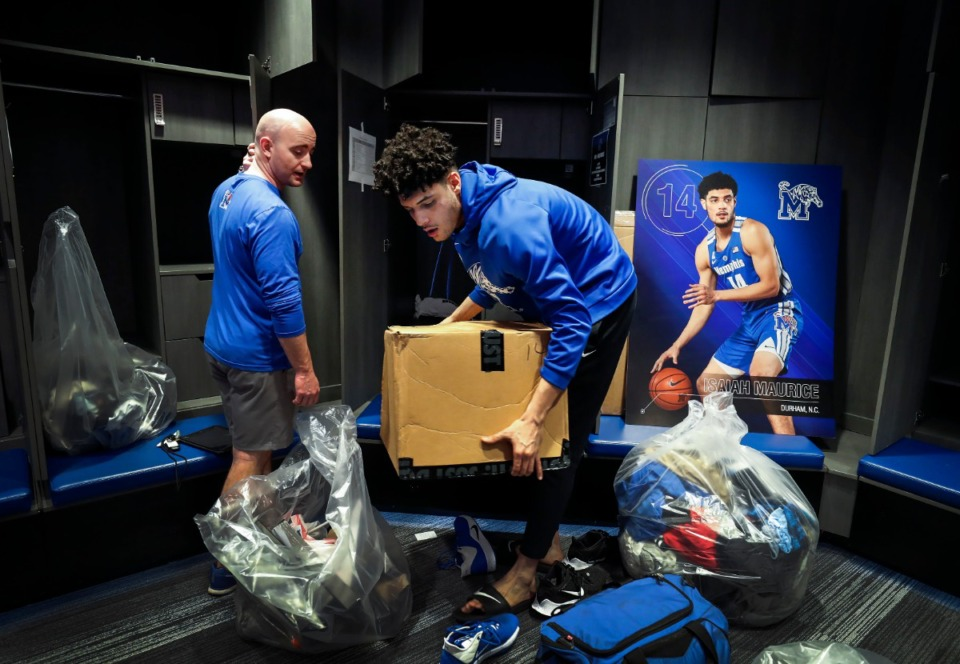 <strong>Tigers senior forward Isaiah Maurice (right) gets help from the team&rsquo;s equipment manager Ryan McPhail (left) while packing up his locker for the last time on Friday, March 13, 2020 at the Laurie-Walton Family Practice Center.</strong> (Mark Weber/Daily Memphian)