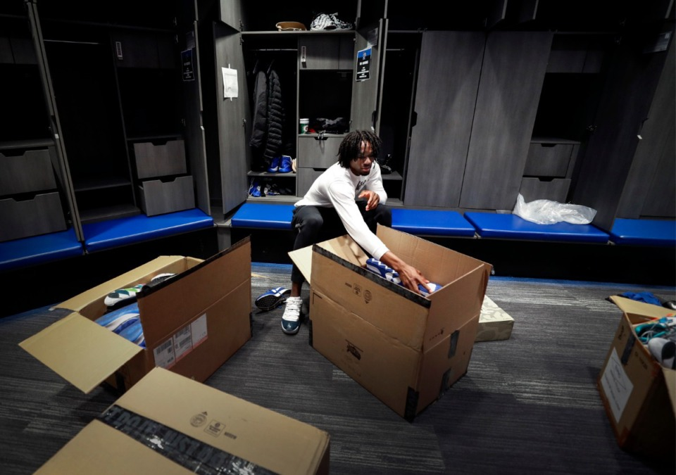 <strong>Tigers freshman forward Precious Achiuwa packs up his locker on Friday, March 13, 2020 at the Laurie-Walton Family Practice Center. The American Athletic Conference Player of the Year is expected to enter the NBA draft.</strong> (Mark Weber/Daily Memphian)