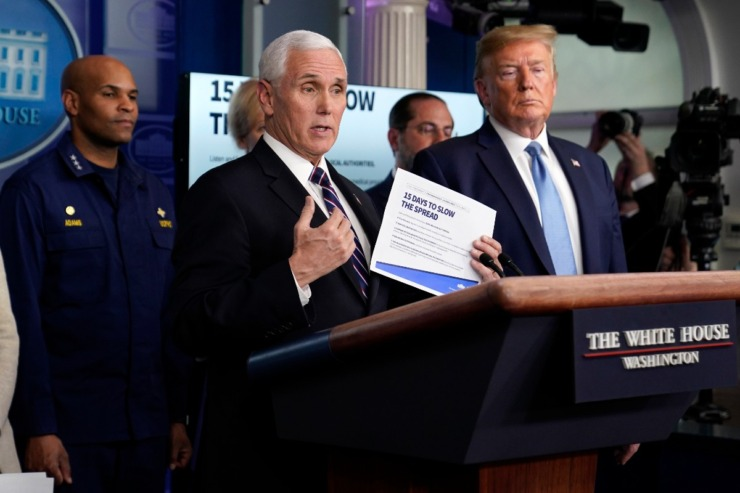 <strong>Vice President Mike Pence speaks as President Donald Trump listens during a press briefing with the coronavirus task force, at the White House, Monday, March 16, 2020, in Washington.</strong> (Evan Vucci/AP)