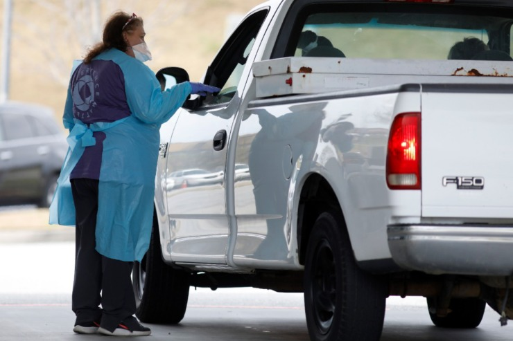 <strong>A healthcare workers conducts a coronavirus test in North Charleston, S.C. Gov. Bill Lee said 15 drive-thru testing stations are being set up in Tennessee</strong>. (Mic Smith/AP)