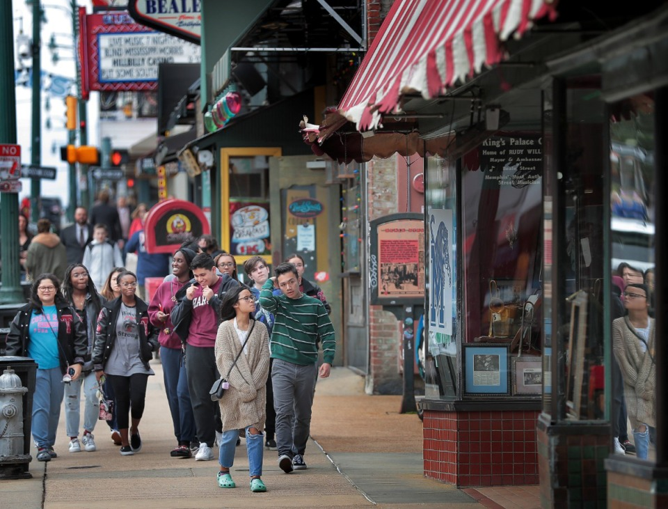 <strong>A smattering of tourists and spring breakers visit Beale Street on March 13, 2020, before the Centers for Disease Control and Prevention began urging a nationwide halt to gatherings of more than 50 people for the next eight weeks</strong>. (Jim Weber/Daily Memphian)