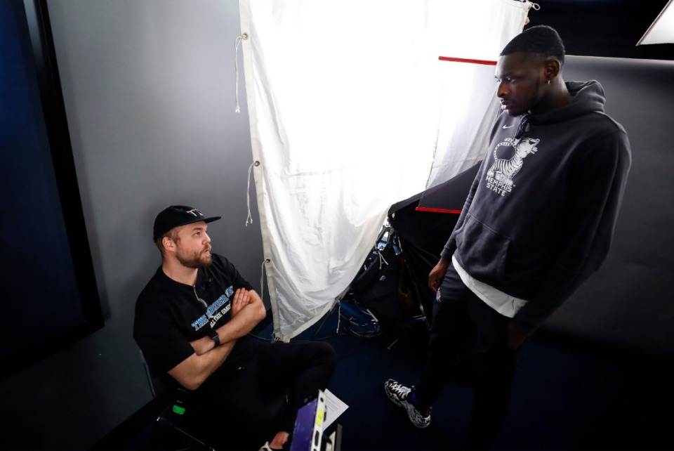 """<strong>Henry Proegler (left) producer of ESPN's """"The Harder Way,"""" chats with Tigers forward Lance Thomas (right) during final interviews for the show on Friday, March 13, 2020.</strong> (Mark Weber/Daily Memphian)"""