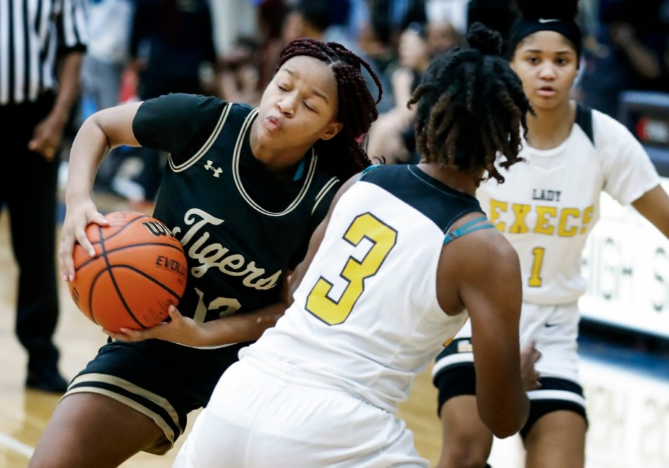 <strong>Whitehaven guard Kakeria Hawkins (left) battles Memphis Business Academy Jan. 2 202, at Arlington High School. Whitehaven was scheduled to play in the state semifinals March 13.</strong> (Mark Weber/Daily Memphian file)