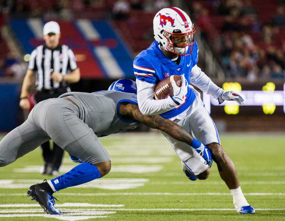 <strong>SMU running back Braeden West (6) is tackled by Memphis defensive back T.J. Carter (2) during the first quarter of the Nov. 16 game in Dallas.</strong> (Ashley Landis/The Dallas Morning News via AP)