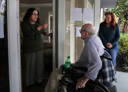 <strong>Iris Depee jokes with Henry Lantrip, a resident of The Glenmary at Evergreen, while his daughter Margaret Walker drops him off after a doctor's appointment March 17, 2020. In light of the coronavirus outbreak, visitors are not permitted inside the assisted living facility.</strong> (Patrick Lantrip/Daily Memphian)