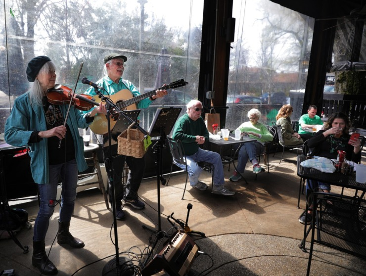 <strong>And the band plays on ... Larkin Bryant (left) and Jim Turpin turn out traditional Irish tunes at Celtic Crossing on St. Patrick's Day March 17, 2020, as pub-goers try to balance everyday life with social distancing in wake on the coronavirus pandemic.</strong> (Patrick Lantrip/Daily Memphian)