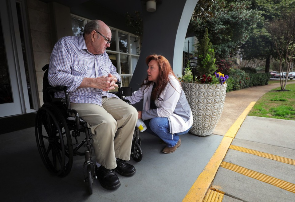 <strong>Margaret Walker sanitizes the wheelchair of her father, 80-year-old Henry Lantrip, while picking him outside of The Glenmary at Evergreen for a doctor's appointment on March 17, 2020. In the light of the coronavirus outbreak, visitors are not permitted inside the assisted living facility.</strong> (Patrick Lantrip/Daily Memphian)