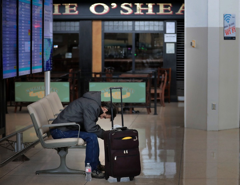 <strong>A weary Dan Aaby waits for a flight home to Roscoe, Illinois, at Memphis International Airport on March, 13, 2020. The airport has temporarily closed the C terminal checkpoint as well as Maggie O&rsquo;Shea&rsquo;s and Moe&rsquo;s Southwestern Grill restaurants due to COVID-19 because passenger numbers have fallen significantly below projections during an expected spring break peak time.</strong> (Jim Weber/Daily Memphian)