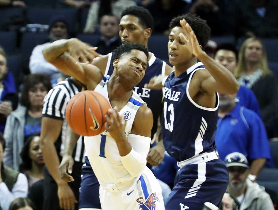 <strong> University of Memphis guard Tyler Harris (1) gets past Yale guard Trey Phills during the Tigers' Nov. 17 matchup against the Bulldogs at FedExForum in Memphis.</strong> (Karen Pulfer Focht/Special to The Daily Memphian)