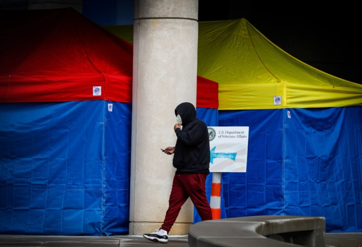 <strong>A man leaves the Memphis VA Medical Center wearing a mask on Wednesday, March 11, 2020. Due to the coronavirus pandemic, the hospital is using tents to pre-screen anyone who enters the facility.</strong> (Mark Weber/Daily Memphian)