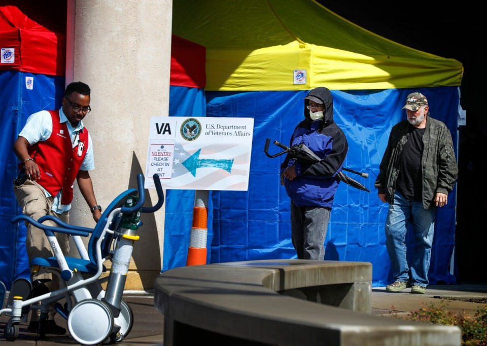 <strong>A man leaves the Memphis VA Medical Center wearing a mask on Wednesday, March 11, 2020. Due to the coronavirus pandemic, the hospital is using tents to pre-screen ayone who enters the facility.</strong> (Mark Weber/Daily Memphian)