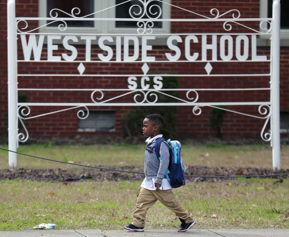 "<strong>A Westside Elementary student walks past the front of his school after getting out of class on March 12, 2020.&nbsp;Shelby County Schools announced they are closing schools, starting March 13 and resuming March 30 &ldquo;due to national developments and rapidly changing conditions regarding the spread of COVID-19,"" said Shelby County Schools Superintendent Joris Ray.&nbsp;</strong> (Patrick Lantrip/Daily Memphian)"