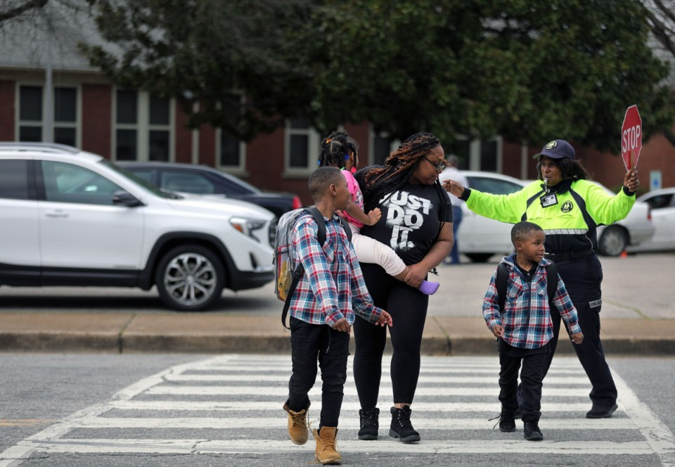 "<strong>Westside Elementary School parent Jacquetta Surney (center) crosses the street after picking her children Dominic McCoy, Damarrhi McCoy and Meilani Surney from school on&nbsp; March, 12 2020.</strong> <strong>Shelby County Schools announced they are closing schools, starting March 13 and resuming March 30 &ldquo;due to national developments and rapidly changing conditions regarding the spread of COVID-19,"" said Shelby County Schools Superintendent Joris Ray.</strong>&nbsp; (Patrick Lantrip/Daily Memphian)"