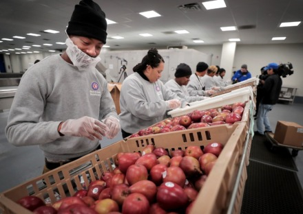<strong>Cadarius Hart joins a line of food prep workers at SCS Nutrition Services to sort meals slated for delivery to a local community center on March 18, 2020.&nbsp;</strong>(Jim Weber/Daily Memphian)