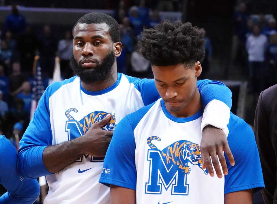 "<p class=""p1""><span class=""s1""><b>Memphis Tigers players honor teammate Karim Sameh Azab with a moment of silence before the Nov. 17 game against Yale at FedExForum in Memphis.&nbsp;Azab died on Nov. 15 after losing his battle with leukemia diagnosed earlier this year.</b>&nbsp;(Karen Pulfer Focht/Special to The Daily Memphian)</span>"