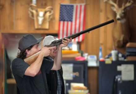 "<strong>Carson Farish checks out a collectable World War II vintage shotgun at the Classic Arms of Memphis gun store in Cordova on March 17, 2020, where guns and ammo are ""flying off the shelves"" as social unrest and home protection become a concern for some in the wake of COVID-19.</strong> (Jim Weber/Daily Memphian)"