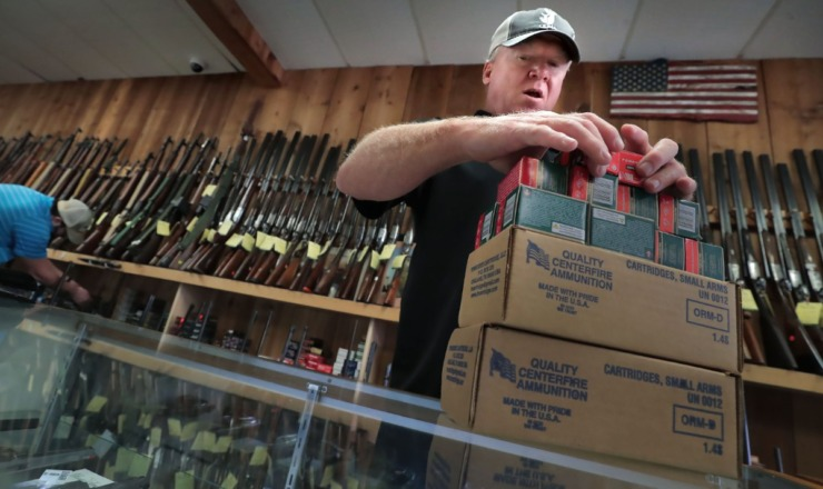 "<strong>Jay Hill, the owner of Classic Arms in Cordova, s</strong><strong>tacks $365 worth of ammunition for a customer.&nbsp;&ldquo;Gun sales here have more than quadrupled,"" he said. ""We're selling 50 guns a day. Ammo sales are probably tenfold.""&nbsp;</strong>(Jim Weber/Daily Memphian)"