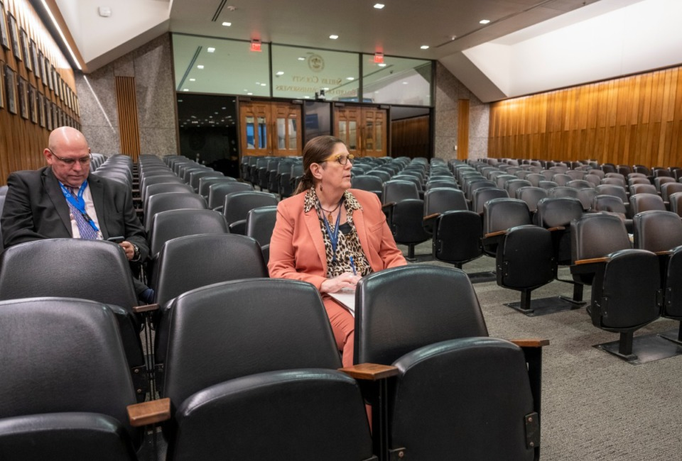 <strong>Shelby County Health Department Director Dr. Alisa Haushalter (right) sits in an empty Shelby County Commission chamber with David Sweat, Chief of Epidemiology for the Shelby County Health Department, while awaiting her briefing with the County Commission on March 18, 2020.</strong> (Greg Campbell/Special to The Daily Memphian)