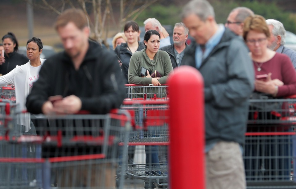 <strong>Shoppers line up outside the busy Costco on Germantown Parkway as management attempts to comply with federal social distancing guidelines by allowing 10-20 customers into the store periodically, a policy designed to control checkout lines and crowding inside the store.</strong> (Jim Weber/Daily Memphian)