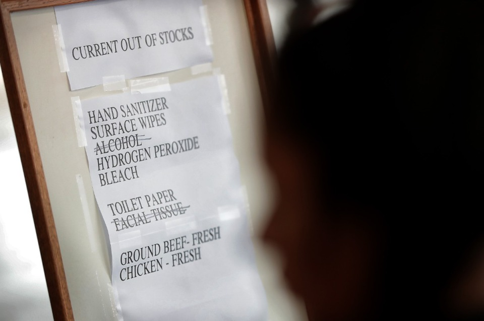 <strong>A list of out-of-stock items greets shoppers lined up outside the busy Costco on Germantown Parkway as management attempts to comply with federal social distancing guidelines by allowing 10-20 customers into the store periodically, a policy designed to control checkout lines and crowding inside the store.</strong> (Jim Weber/Daily Memphian)