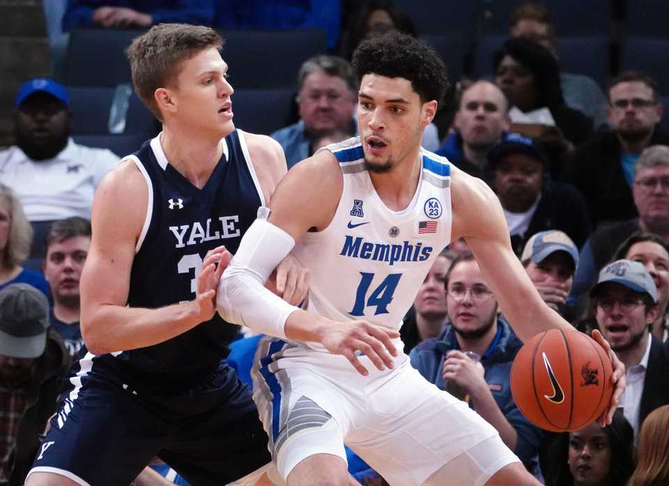"<p class=""p1""><span class=""s1""><b>University of Memphis forward Isaiah Maurice (14) gets around Yale forward Blake Reynolds (32) during the Nov. 17 game at FedExForum in Memphis.</b>&nbsp;(Karen Pulfer Focht/Special to The Daily Memphian)</span>"