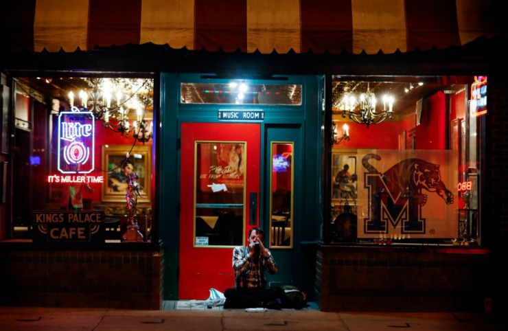 <strong>Harmonica player Michael Blumenthal performs in front of the empty Kings Palace Cafe&nbsp;on St. Patrick's Day on Tuesday, March 17, 2020. Area restaurants and bars are experiencing a smaller number of customers due to the outbreak of coronavirus.</strong> (Mark Weber/Daily Memphian)