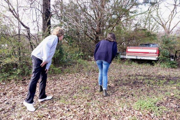 <strong>Debby Dalhoff (left) and Meaghan Ybos, also a rape survivor, tiptoe onto the edge of a property where Dalhoff believes her assailant once lived.&nbsp;</strong>(Karen Pulfer Focht/Special to The Daily Memphian)