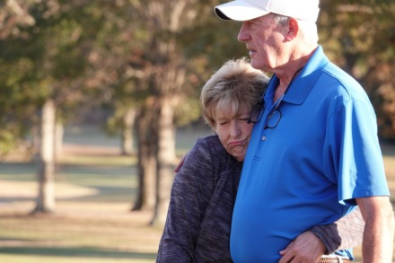 <strong>Debby Dalhoff has found peace and a loving and supportive community in the game of golf. She gets a hug between holes from Bo Briggs.</strong> (Karen Pulfer Focht/Special to The Daily Memphian)
