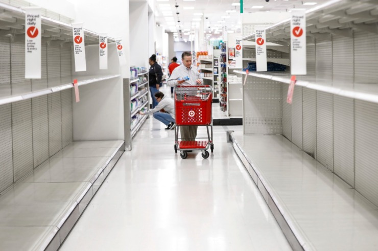 <strong>Customers shop the empty paper goods aisle at the Target Memphis Central Store on Wednesday, March 18, 2020.</strong> (Mark Weber/Daily Memphian)