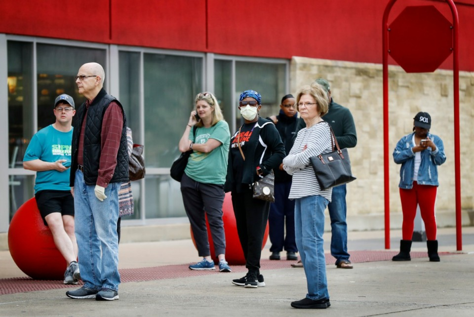 <strong>Target Memphis Central customers wait outside the store before it opens on Thursday, March 19, 2020. Since the outbreak of the coronavirus, the store replaces their cleaning supplies and paper good daily and by the afternoon they are gone.</strong> (Mark Weber/Daily Memphian)