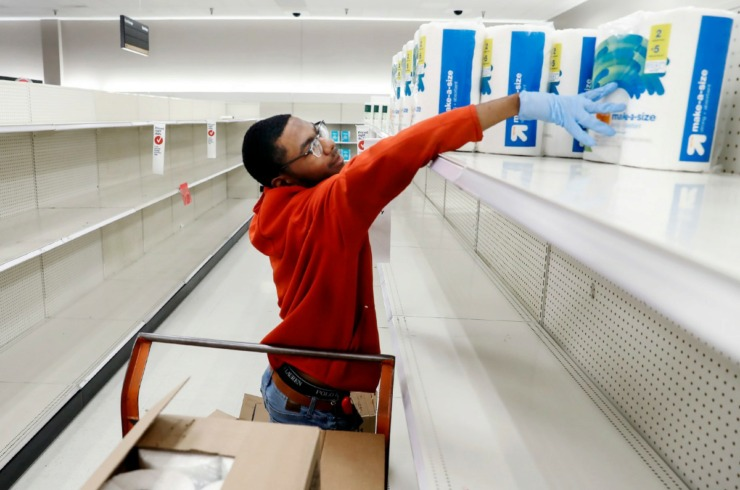 <strong>Target Memphis Central team member Davunshae Gainer stocked depleted shelves with paper towels on Thursday, March 19, 2020. Since the outbreak of the coronavirus, the store replaces their cleaning supplies and paper good daily and by the afternoon they are gone.</strong> (Mark Weber/Daily Memphian)