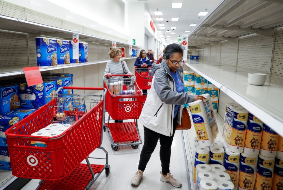 <strong>Target Memphis Central customers form a line as they grab toilet paper on Thursday, March 19, 2020. Since the outbreak of the coronavirus, the store replaces their cleaning supplies and paper good daily and by the afternoon they are gone.</strong> (Mark Weber/Daily Memphian)