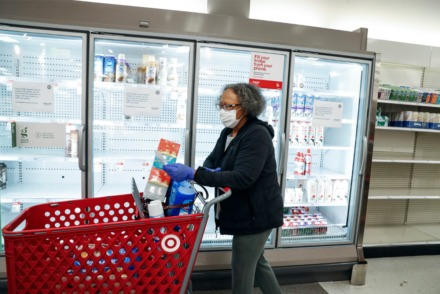 <strong>Target Memphis Central customer Aggie Gaddy wears a medical face mask while perusing depleted grocery aisles on Thursday, March 19. Since the outbreak of the coronavirus, the store replaces its cleaning supplies and paper goods&nbsp; daily and by the afternoon they are gone.</strong> (Mark Weber/Daily Memphian)