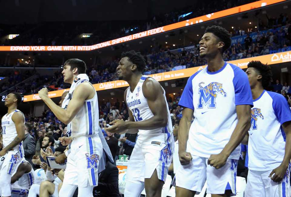 "<strong>The University of Memphis bench cheers on their teammates&nbsp;<span class=""s1"">during the Nov. 17 game against Yale at FedExForum in Memphis.&nbsp;</span></strong><span class=""s1"">(Karen Pulfer Focht/Special to The Daily Memphian)</span>"