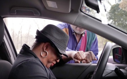 "<strong>Joyce Hamilton (in car) stopped by the Holy City Church of God in Christ in Memphis on March 19, 2020, to ask for prayers of encouragement with church Elder&nbsp;Mark Walker at the Raleigh church's ""drive-thru prayer.""&nbsp;</strong>(Karen Pulfer Focht/Special to The Daily Memphian)"