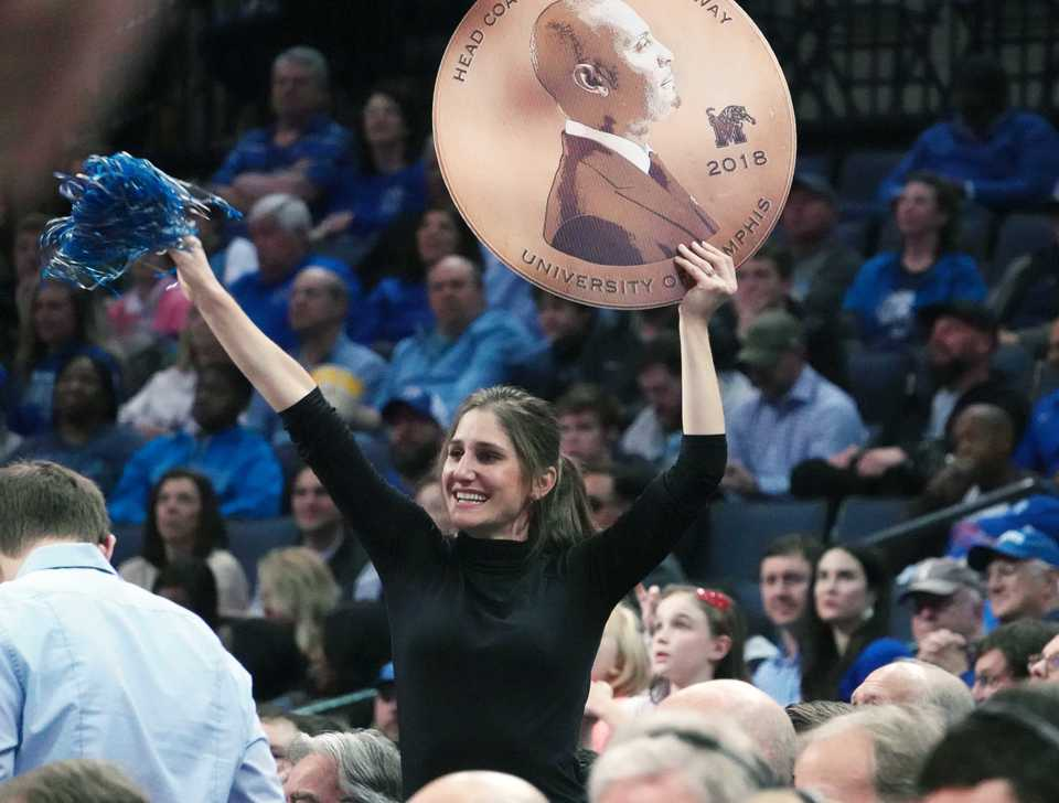 "<strong>A University of Memphis fan holds a huge new ""penny"" with coach Penny Hardaway's picture during the Tigers'&nbsp;during the Nov. 17 game against Yale at FedExForum in Memphis.</strong>&nbsp;(Karen Pulfer Focht/Special to The Daily Memphian) <p class=""p2"">"