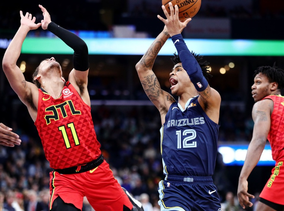 <strong>Memphis Grizzlies guard Ja Morant (12) drives to the basket against Atlanta Hawks guard Trae Young (11) during a March 7, 2020, game at the FedExForum against the Atlanta Hawks.</strong> (Patrick Lantrip/Daily Memphian file)