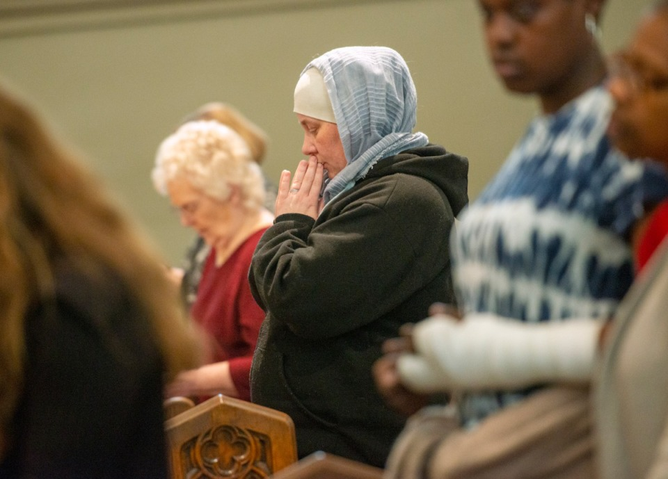 <strong>Monika Coats prays during the mass marking the 180th anniversary of the first Catholic Mass in Memphis, Sunday, Nov. 17, 2019 at St. Peter Church.</strong> (Greg Campbell/ Special for The Daily Memphian file )