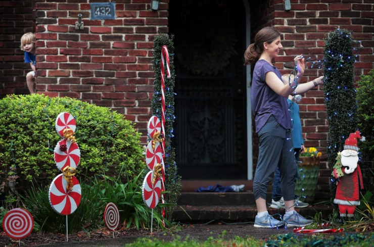 <strong>Ashley Baker, her husband, Ryan, and their three kids pulled out strings of lights, candy cane yard art and their 12-year-old Frosty standup to decorate their Midtown yard on March 20, 2020.</strong>&nbsp; (Jim Weber/Daily Memphian)