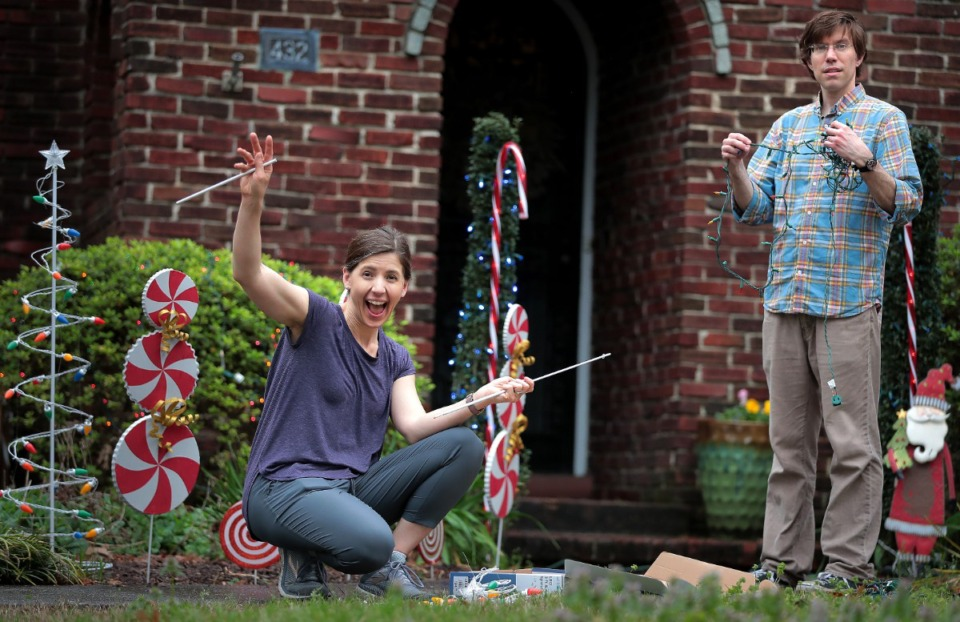 """<strong>""""It just feels like a dark time, and Christmas lights seemed to be a good way to bring some light to our neighborhood."""" said Ashley Baker as she, her husband Ryan and their three kids pulled out strings of lights, candy cane yard art , and their 12-year-old frosty standup to decorate their Midtown yard on March 20, 2020. Baker also admitted that it was a good way to get the kids out of the house and participating in a family activity as many Memphians start to feel a little cabin fever forced to lock down their homes in leu of spring break fun.</strong> (Jim Weber/Daily Memphian)"""