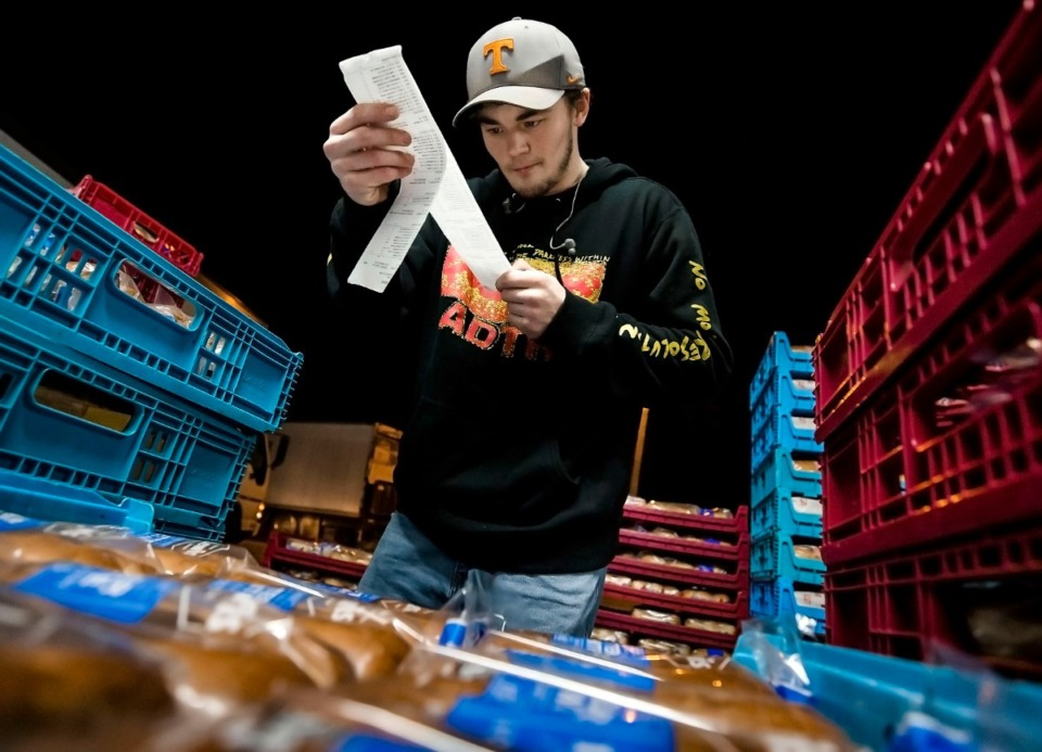 <strong>Scotty Oates preps his truck full of bread supplies at his Raleigh-Frayser starting point before beginning his multi-city delivery route after midnight on March 21, 2020.</strong> (Ziggy Tucker/Special to The Daily Memphian)