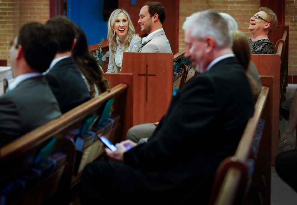 <strong>Newlyweds Holly Whittle and John Steinert smile during the their wedding with immediate family on Saturday, March 21, 2020, at St. Louis Catholic Church.</strong> (Mark Weber/Daily Memphian)
