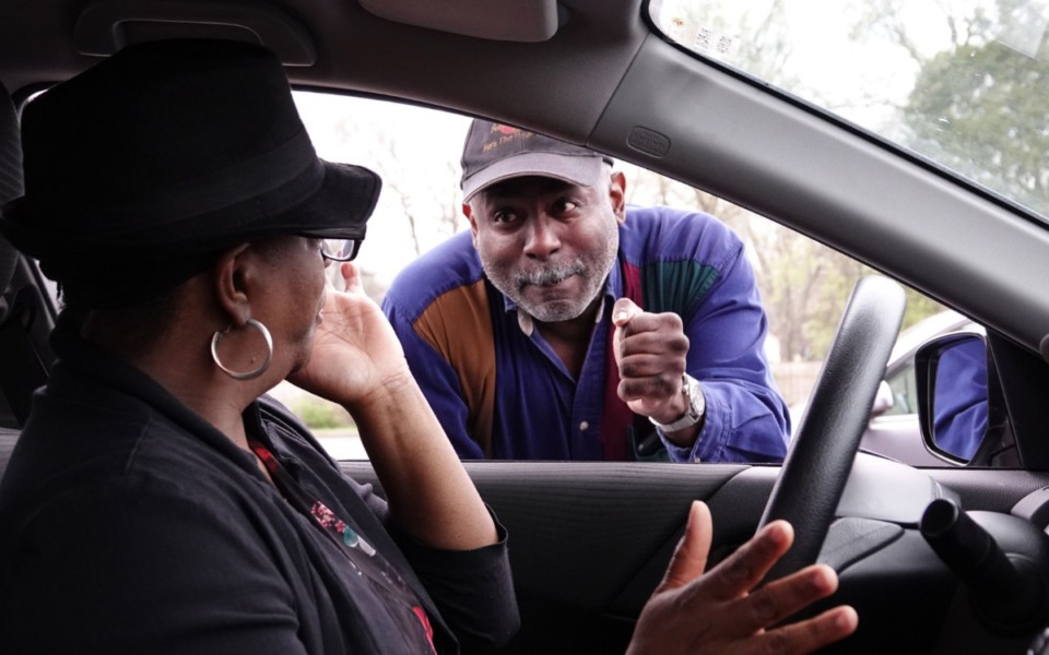 <strong>Joyce Hamilton gets words of encouragement from elder Mark Walker at the drive-thru prayer lane at Holy City Church of God in Christ at&nbsp;<span>3208 James Road</span> on Thursday, March 19. The church offers drive-thru prayer once a week for members and non-members alike every Thursday morning.</strong> (Karen Pulfer Focht/Special to Daily Memphian)