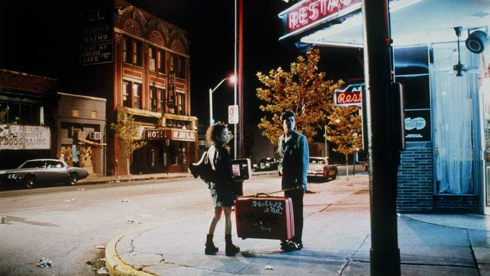 "<strong>The since-demolished Arcade Hotel looms in the background as a couple of Japanese tourists take in the corner of Main and G.E. Patterson (then Calhoun) in Jim Jarmusch's made-in-Memphis 1989 film ""Mystery Train.""</strong> (Criterion Collection)"