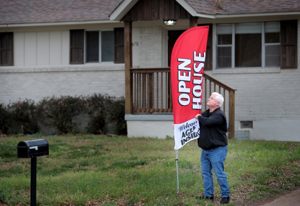 <strong>Realtor Brad Vaughan puts out signs to draw prospective home buyers to an open house at his listing on Mesquite Road in East Memphis on Saturday, March 21. The business of selling property continues in Memphis, but with precautions, due to the COVID-19 pandemic.</strong> (Jim Weber/Daily Memphian)