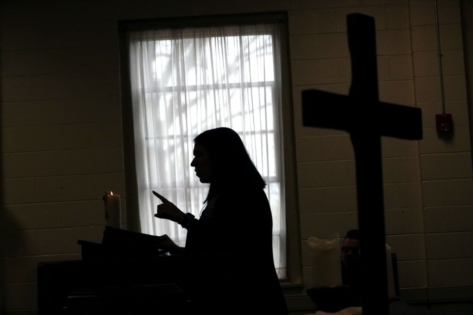 <strong>Rev. Sara K. Corum, pastor at Trinity United Methodist Church in Memphis, preaches to her congregation in a live stream on Sunday morning, March 22, 2020, from an empty room in her Midtown church.</strong> (Karen Pulfer Focht/Special to the Daily Memphian)