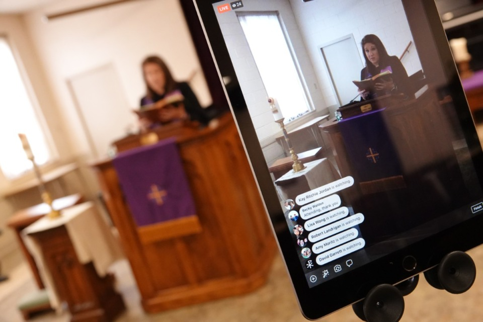 <strong>The names of some people watching the Sunday, March 22 sermon are visible on the screen as Rev. Sara K. Corum preaches at Trinity United Methodist Church in Memphis.</strong> (Karen Pulfer Focht/Special to the Daily Memphian)