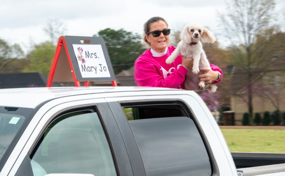 <strong>A Bailey Station Elementary School preschool teacher rides through the neighborhoods of the school's students with her dogs Monday, March 23, 2020.</strong> (Greg Campbell/Special to The Daily Memphian)