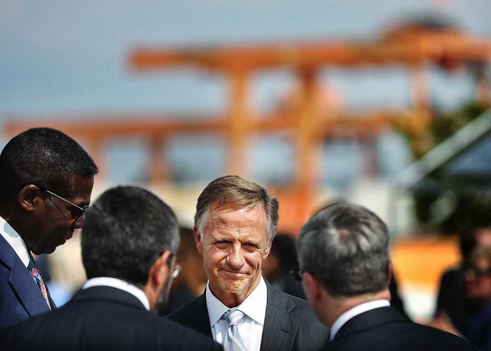 <strong>Tennessee Gov. Bill Haslam talks to railroad executives at the BNSF intermodal terminal on Aug. 22, 2018, about a recent grant to fund road improvements along the Lamar corridor.</strong> (Jim Weber/Daily Memphian)