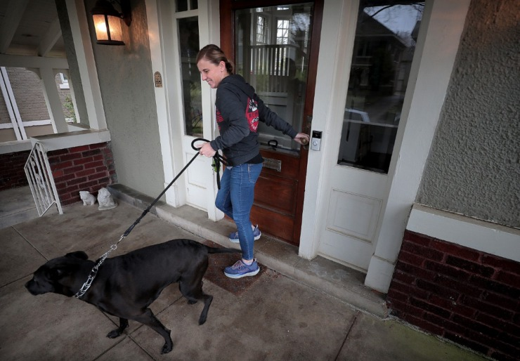 "<p style=""text-align: center;"">Downtown Memphis Commission president Jennifer Oswalt takes her dog Stax for a walk on March, 24, 2020, in her Central Gardens neighborhood where she is working from home. Oswalt says her dog likes the arrangement cause he is getting three walks a day now. (Jim Weber/Daily Memphian)"